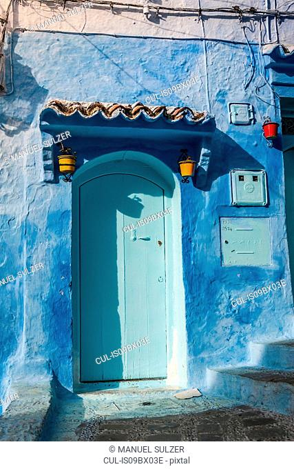 Blue painted house exterior and doorway, Chefchaouen, Morocco