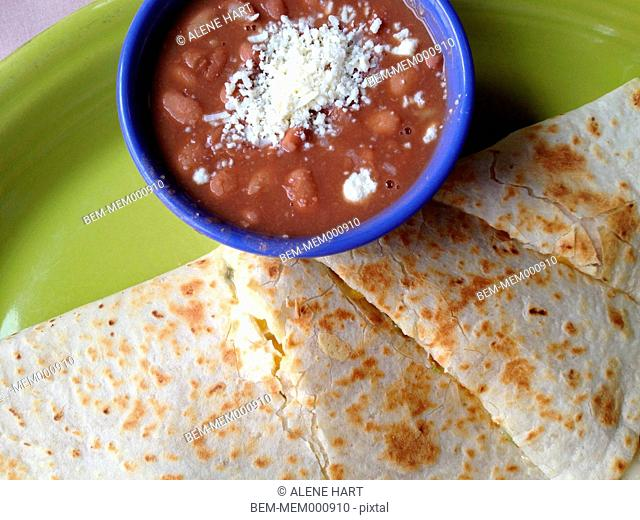 Close up of beans and quesadilla