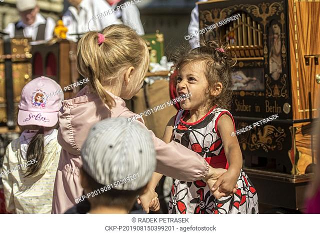 Little children dance at the 10th annual barrel organ players international meeting, which starts in historical centre of Liberec, Czech Republic on August 15