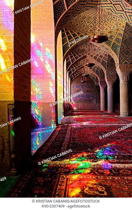 Inside the winter prayer hall of Nazir-al Molk Mosque (Masjed-e Nazir-al-Molk) with the morning sun sending colorful rays through the stained glass, Shiraz
