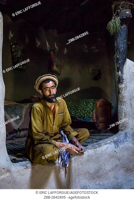 Afghan man inside his traditional pamiri house, Badakhshan province, Khandood, Afghanistan