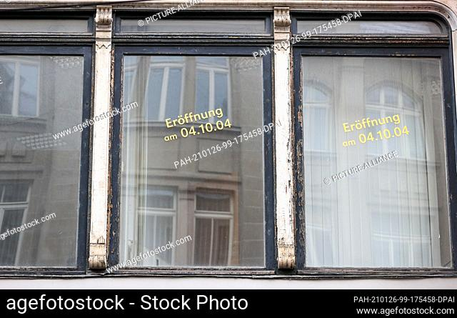 26 January 2021, Saxony-Anhalt, Halle (Saale): Stickers on a window indicate a planned opening on 04.10.2004. Photo: Jan Woitas/dpa-Zentralbild/dpa