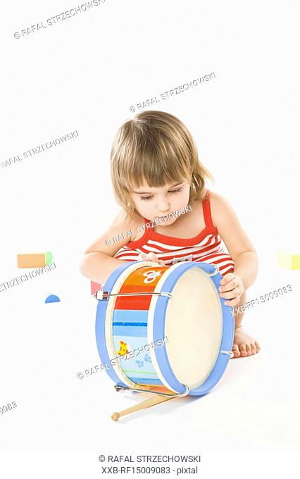 baby playing on drum
