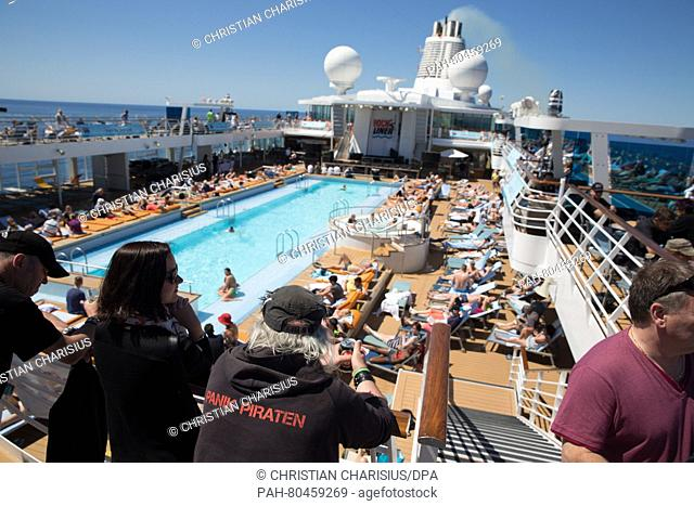 Guests on a cruise ship enjoying the sun at the pool on the cruise ship 'Mein Schiff 3' on the journey from Gibraltar to Ibiza, Spain, 3 May 2016