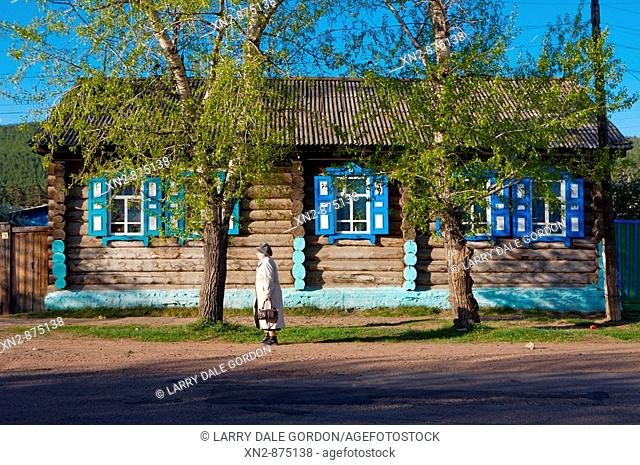 Russia. Tarbagatai Villlage of Old Believers of original Russian Orthodox. Colorful window treatment