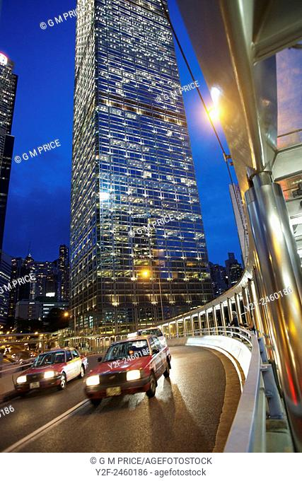 dusk traffic on curved, elevated roadway in the Admiralty district, with sections of Bank of China Tower and Chung Kong Centre buildings, Hong Kong