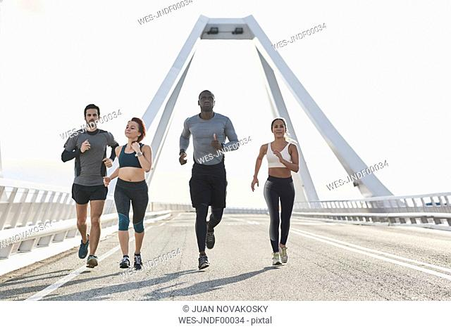 Group of sportspeople jogging