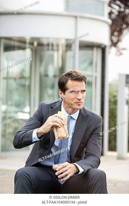 Businessman having lunch outdoors