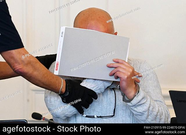 15 September 2021, Baden-Wuerttemberg, Karlsruhe: A 43-year-old defendant is waiting in the jury courtroom of the Karlsruhe Regional Court for his trial to...
