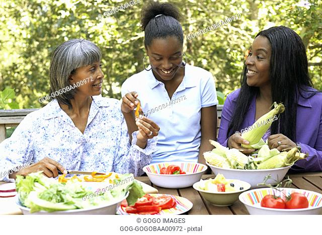 African women eating together outdoors