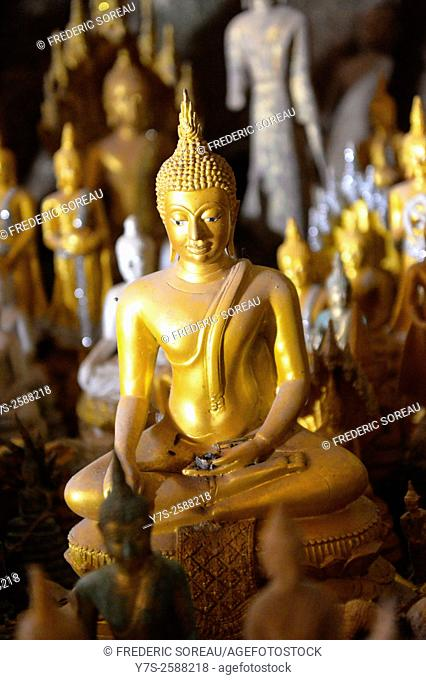 Statue of Buddha inside Pak Ou Buddha Cave at the Mekong River near Luang Prabang in the north of Laos, South East Asia
