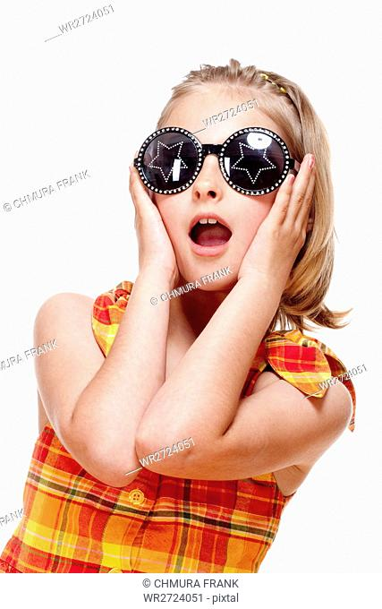 Little Girl with Blond Hair and Funny Glasses - Isolated on White