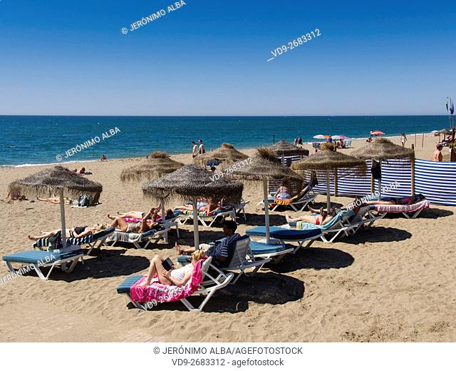 Tourists on the beach. Mijas Costa, Malaga province, Costa del Sol, Mediterrenean sea, Andalusia, Spain Europe