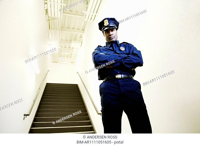 Security guard standing by staircase