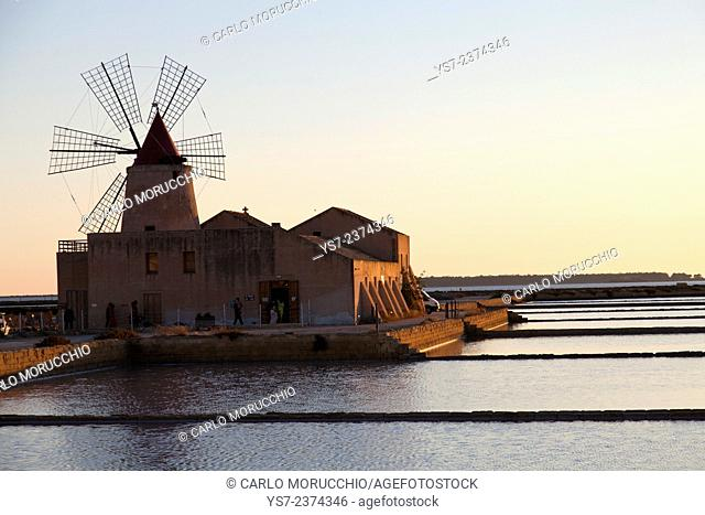 Saltworks and the picturesque windmill at the Stagnone lagoon, Marsala, Sicily, Italy, Europe
