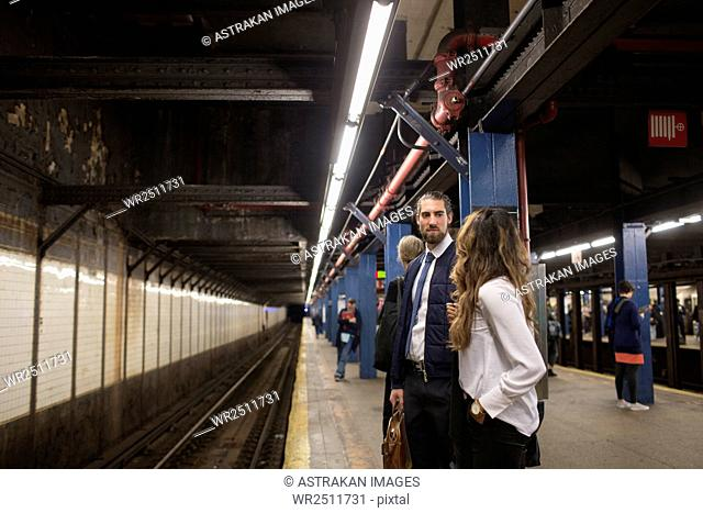 Colleagues waiting for train at subway station