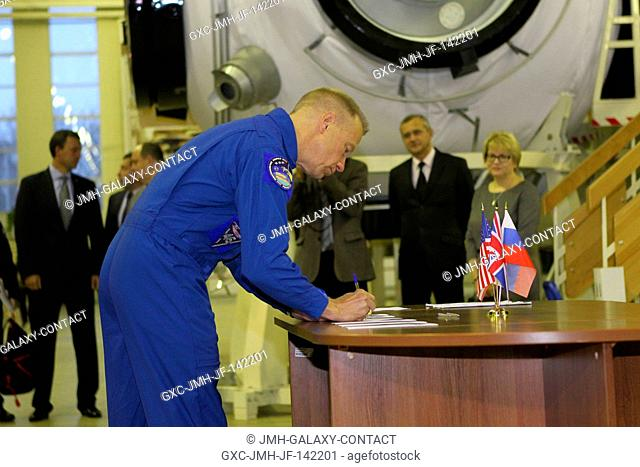 At the Gagarin Cosmonaut Training Center in Star City, Russia, Expedition 46-47 prime crewmember Tim Kopra of NASA signs in for the start of two days of...