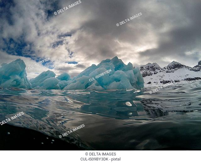 Under and over view of arctic ocean and iceberg, Burgerbukta, Spitsbergen, Svalbard, Norway