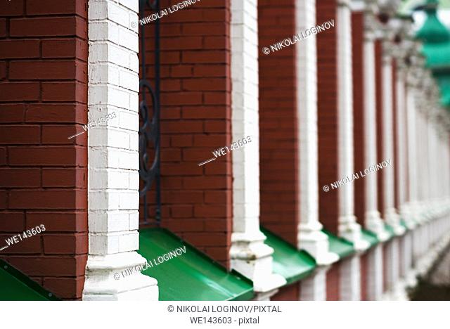 Vertical Russian temple red brick fence background