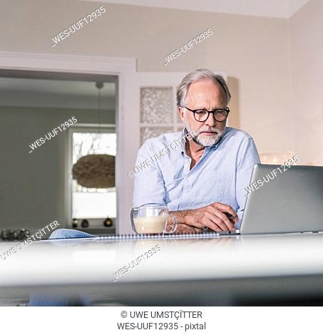 Portrait of businessman working at home office