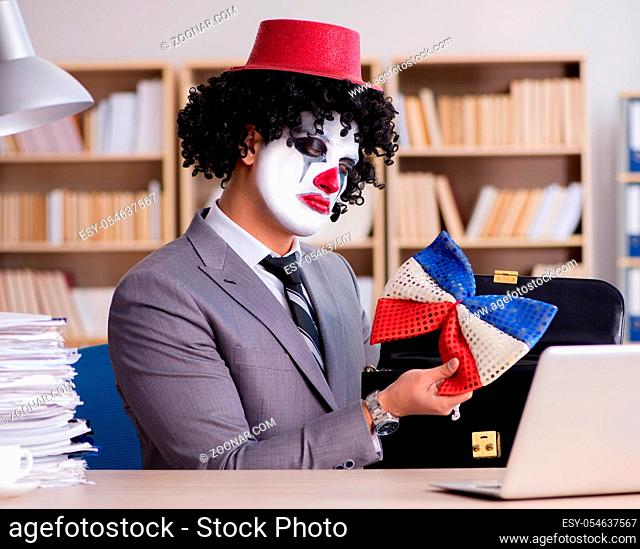 The clown businessman working in the office