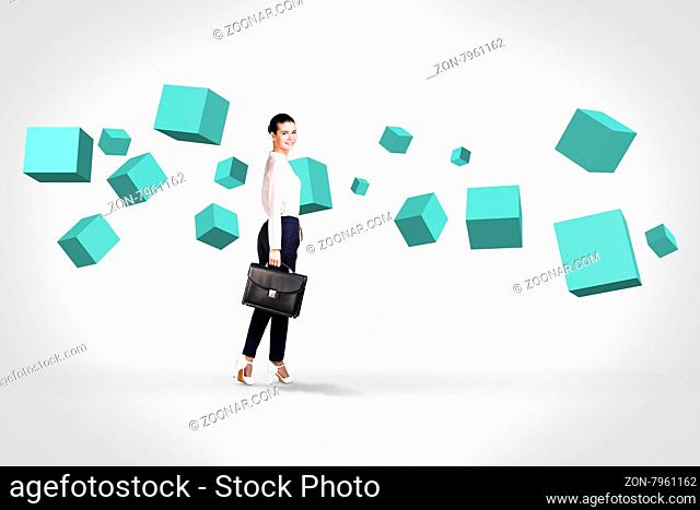 Business woman stands near turquoise cubes suspended in the air. Abstract isolated on white