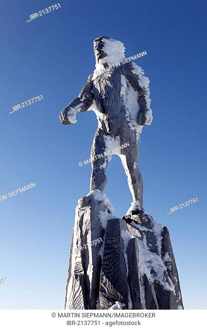 Wood sculpture, Sky Trooper, by Mario Gasser at the summit of Zugspitze Mountain, Wetterstein Mountains, Tyrol, Austria, Europe