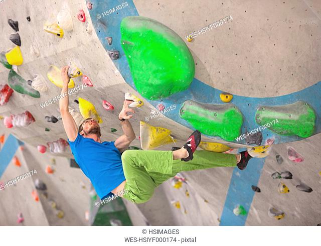 Germany, Bavaria, Munich, Young man bouldering
