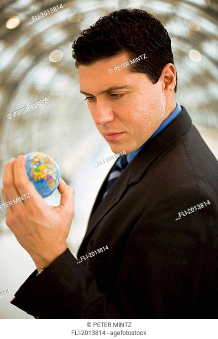 Business Man Holding The World In His Hand
