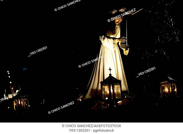 Men carry the statue of Christ carrying the cross during a Holy Week procession in the town of Prado del Rey in southern Spain's Cadiz Sierra region in...