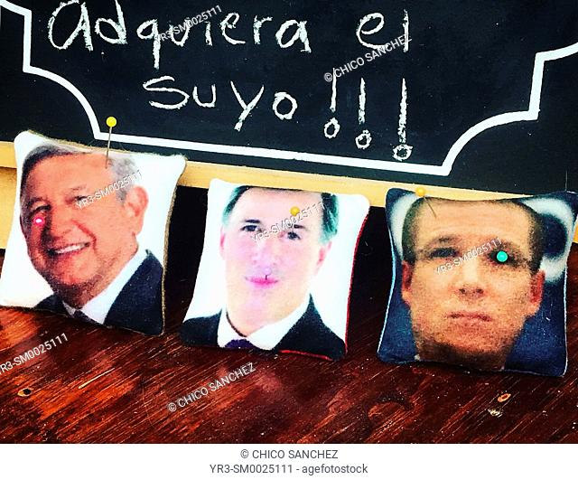 Cushions for sewing needles decorated with portraits of Mexican President, Andres Manuel Lopez Obrador (left), from Morena party