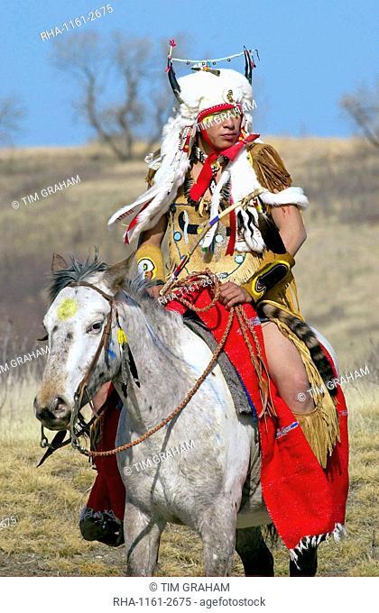 Canadian Plains Indians chief on horseback at cultural display at Wanuskewin Heritage Park in Saskatoon, Canada