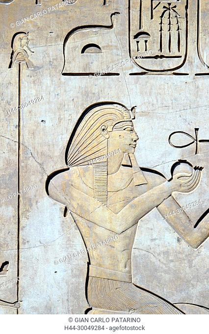 Karnak, Luxor, Egypt. Temple of Karnak sacred to god Amon: the pharaoh Horemheb offers two wine vases nu