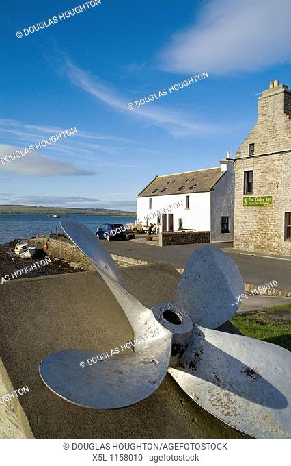 St Margarets Hope SOUTH RONALDSAY ORKNEY Ship propellor display at waterfront quayside harbour houses town