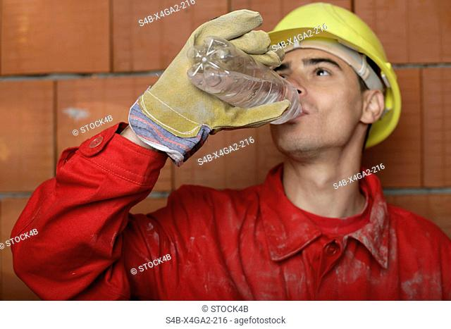 Building worker drinking water