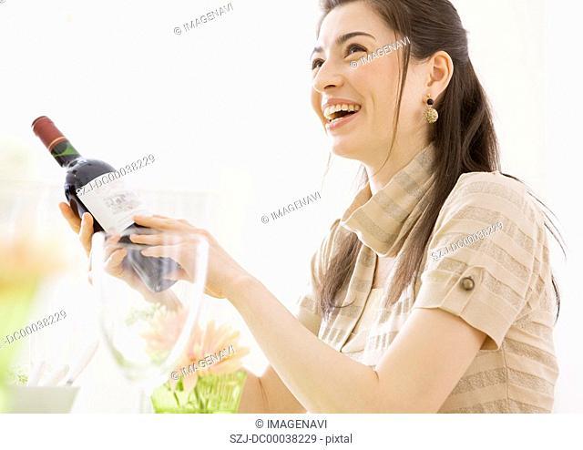 Woman holding wine bottle
