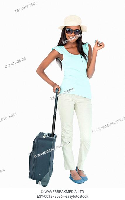Smiling young woman going on vacation against a white background