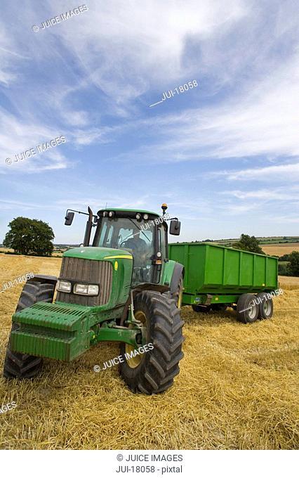 Tractor in barley field