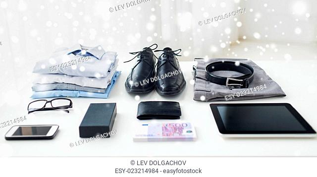 business, style, clothes and objects concept - close up of formal male clothes and personal stuff on table at home over snow effect