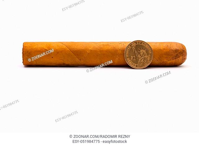 Luxury Cuban cigar and one dollar on the white background