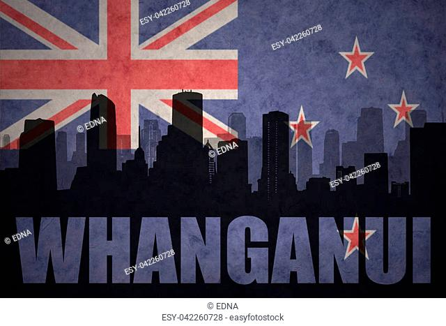 abstract silhouette of the city with text Whanganui at the vintage new zealand flag background