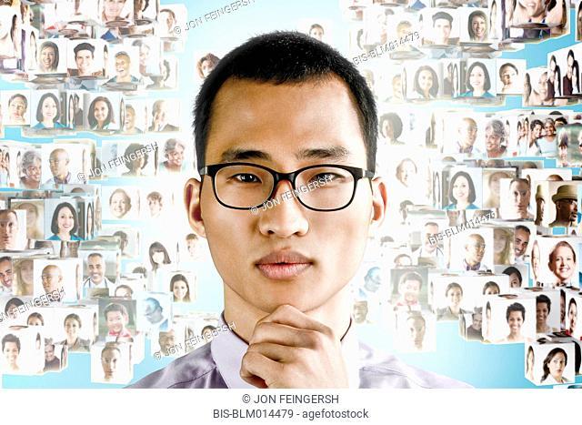 Images of business people behind Korean businessman