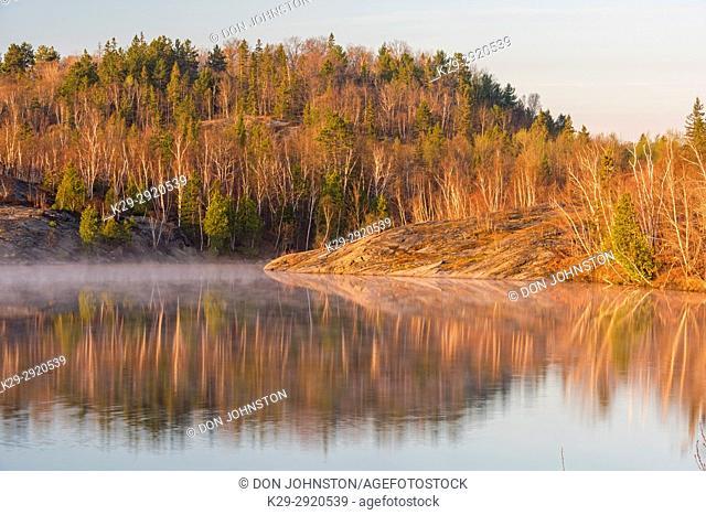 Early spring morning mists on Simon Lake, Greater Sudbury, Ontario, Canada