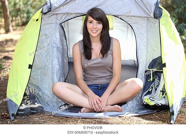 Brunette girl in front of tent