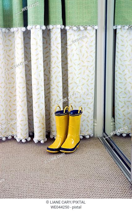 Yellow boots in mirror