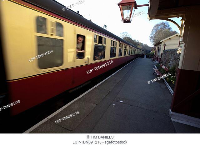 England, North Yorkshire, Goathland. A heritage railway train passing through Goathland station on the North Yorkshire Moors Railway