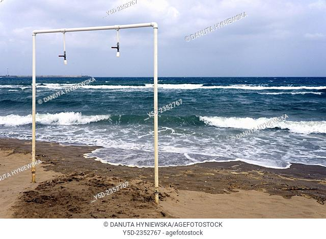 simple showers directly on the beach, Catania beach, Sicily, Italy, Europe
