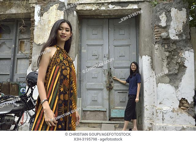 young Indonesian girl posing with a batik dress in the Kepodang Street, Old Town of Semarang, Java island, Indonesia, Southeast Asia