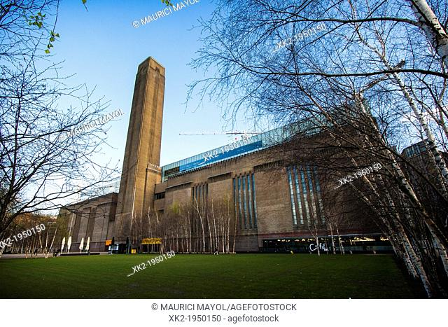 Tate Modern whole front view with trees, London, UK
