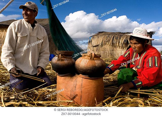 Uros Island, Lake Titicaca, peru, South America. A family prepares breakfast on the island of Los Uros located inside Lake Titicaca
